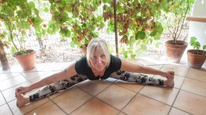 Ady doing seated forward bend on the terrace